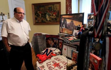 "Jim Kasper (left) with some of the mementos from his son's life, displayed in their Newton home. ""There are people who feel I should just go on with my life,"" says Kasper. ""But he was my only son. I loved him."""